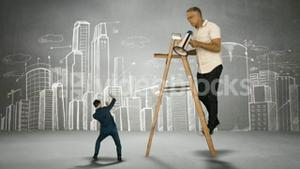 Boss on ladder yelling on scared businessman