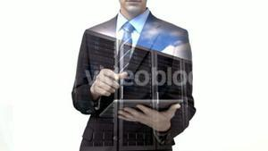 Businessman using tablet computer with data server overlay