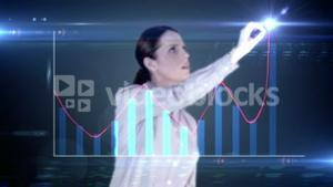 Happy businesswoman drawing hologram graph on blackbackground