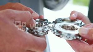 Close up view of business people hands holding wheels