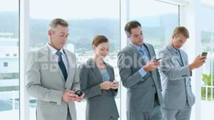 Business people using smartphone in office