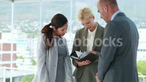 Business people looking at notebook