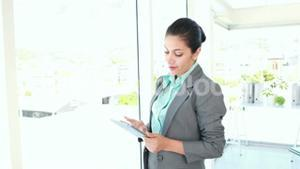 Happy businesswoman using tablet computer