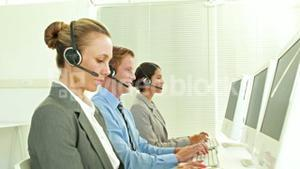 Business team working in call center