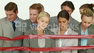 Business people surrounding by red strip
