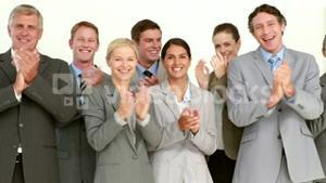 Business people applauding in front of camera