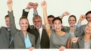 Business people cheering in front of camera