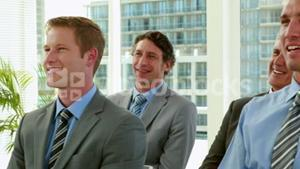Business people smiling during conference