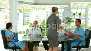 Happy businesswoman holding medical folder