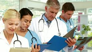 Serious medical team working in medical office