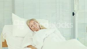 Patient sleeping on medical bed