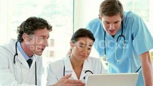 Medical team working on laptop computer