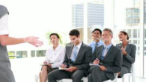 Business people asking question during presentation