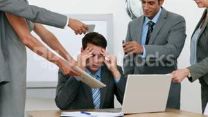 Anxious businessman sitting with hands on head