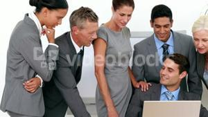 Business people looking at laptop computer