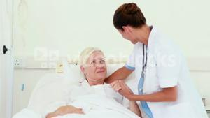 Doctor speaking with her patient