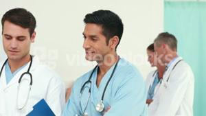 Happy medical team looking at camera