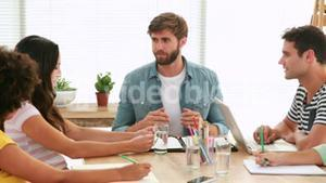 Casual business team having meeting