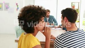 Two casual business worker chatting during meeting