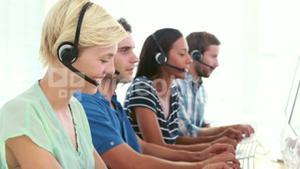 Happy call centre agents talking on the headset