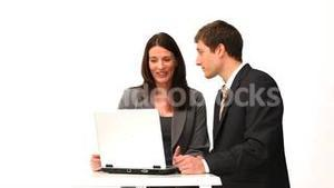 Business people speaking in front of a laptop