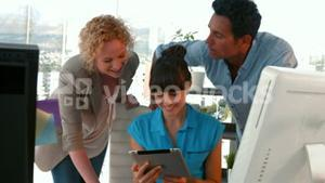 Casual business team working with tablet