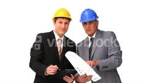 Architects looking at the construction plan