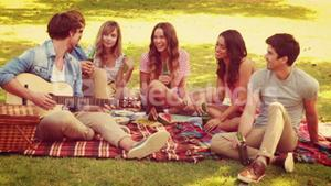 Happy friends talking together in the park