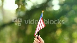 Close up of little boy waving american flag