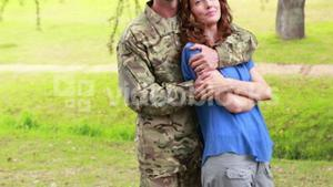 Happy soldier hugging his wife