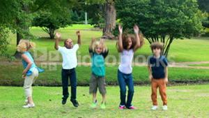 Happy children jumping together in park