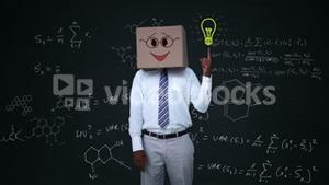 Businessman hiding head with happy box and pointing light bulb