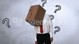 Businessman looking down with box on head