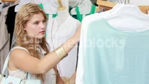 Pretty blonde shopping for clothes