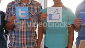 Creative business team showing social network logo