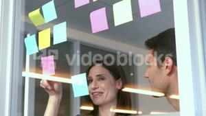 Casual business people looking at post it