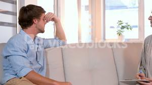 Casual businessman speaking with psychologist