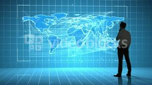 Businessman looking at a global business interface