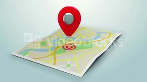 Red marker pointing at a map of a town
