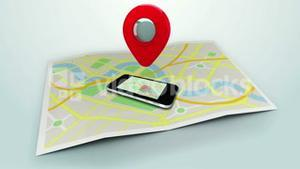 red marker pointing at a mobile lying on a map of a town