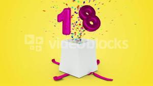 Birthday gift exploding with confetti and balloon eighteen against yellow background