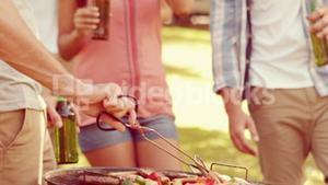 Happy group of friend doing barbecue in the park