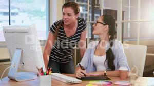 Casual businesswomen looking at computer