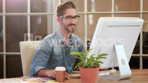 Casual businessman working on computer