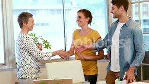 Casual business team shaking hands