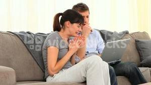 Couple are scared in front of their laptop