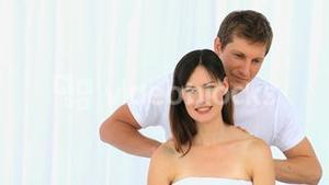 Man doing a massage to his wife