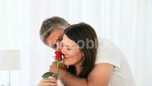 Cute middle aged couple with a flower