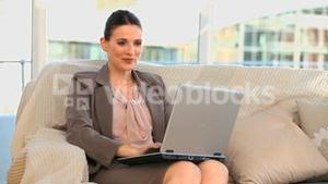 Happy business woman with a laptop