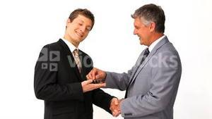 Businessman giving keys to an other man